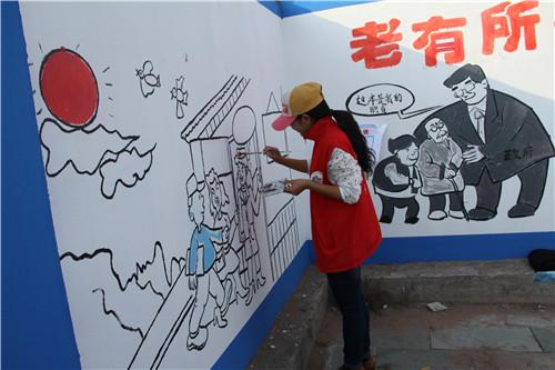 札萨克镇:手绘中国梦亮丽文化墙-内蒙古文明网